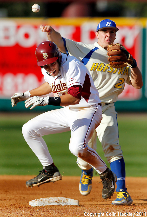 TALLAHASSEE, FL 2/26/11-FSU-HOFSTRA BASE11 CH-Florida State's Justin Gonzalez ducks under the throw of Hofstra's Boby Gazzola after he was thrown out at second  during second inning action Saturday at Dick Howser Stadium in Tallahassee. The Seminoles beat the Pride 16-3...COLIN HACKLEY PHOTO