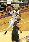 SIOUX FALLS, SD - DECEMBER 5:  Charles Ward #22 from the University of Sioux Falls takes the ball to the basket around Grant Lang #21 from Upper Iowa in the second half of their game Friday night at the Stewart Center.  (Photo by Dave Eggen/inertia)