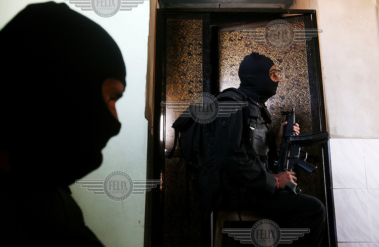 National Security Guard (NSG) commando snipers wait for orders to shoot in front of Nariman House, home to the Hasidic Jewish group Chabad-Lubavitch, where hostages were being held after terrorists launched multiple attacks in Mumbai on 26/11/2008..