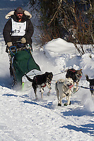 Musher Kirk Barnum on Long Lake at the Re-Start of the 2011 Iditarod Sled Dog Race in Willow, Alaska.