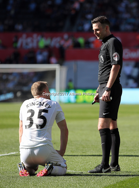 SWANSEA, WALES - APRIL 22: Referee Michael Oliver (R) speaks to after Stephen Kingsley of Swansea City after he was fouled during the Premier League match between Swansea City and Stoke City at The Liberty Stadium on April 22, 2017 in Swansea, Wales. (Photo by Athena Pictures/Getty Images)