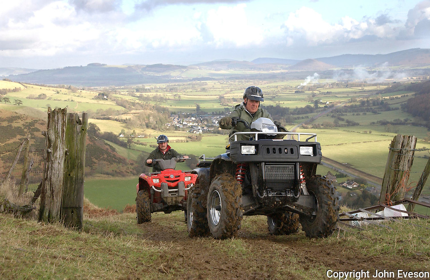 Two All Terrain Vehicles climbing a hill in Wales.