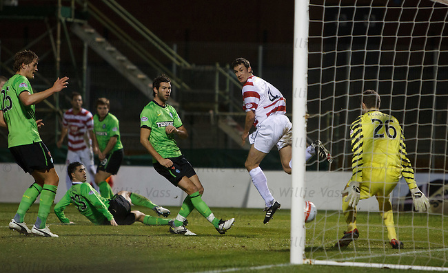 Martin Canning backheels the ball across the Celtic goal for Simon Mensing to tap in to score