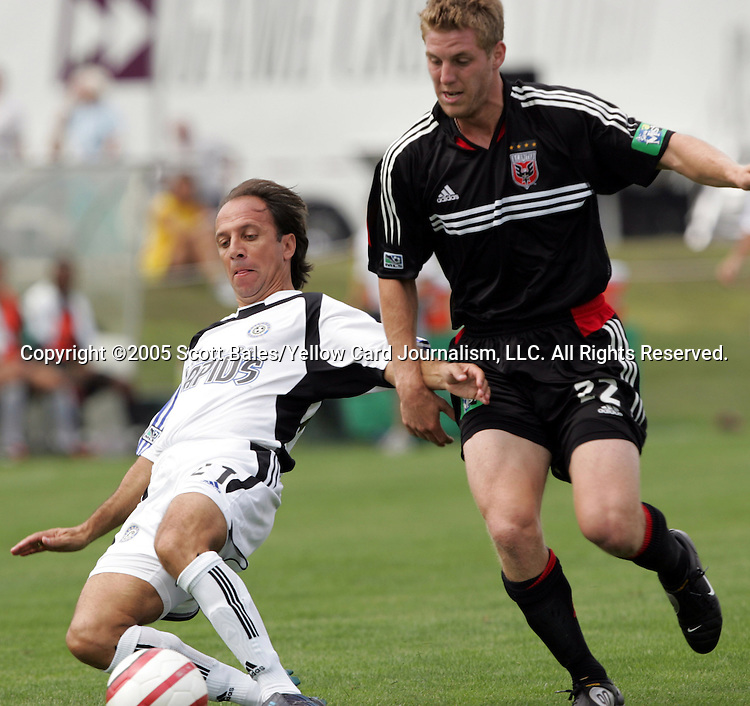29 August 2005: Newly elected Hall of Famer and Colorado head coach Fernando Clavijo (left), watched by DC United's Jason Thompson. The Colorado Rapids defeated DC United 6-2 at At-A-Glance Field in Oneonta, New York in the 2005 Hall of Fame Game..