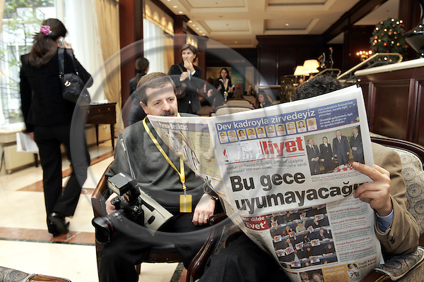 BRUSSELS - BELGIUM - 16 DECEMBER 2004 -- The Turkish have taken over the Konrad Hotel in Brussels during the EU-Summit. -- A Turkish journalist reading a Turkish newspaper while waiting.  -- PHOTO: JUHA ROININEN / EUP-IMAGES