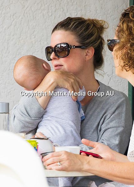 19 OCTOBER 2015 SYDNEY <br /> AUSTRALIA<br /> <br /> EXCLUSIVE PICTURES<br /> <br /> Home &amp; Away actress Emily Symons pictured out with her 'miracle' baby boy Henry for the first time since giving birth in August. Emily kept her first adventure out of doors close to home with a little stroll to a local cafe to meet a friend for brunch. Emily was seen dotting over the tiny tot and giving him a feed from a bottle. <br /> <br /> *ALL WEB USE MUST BE CLEARED*<br /> <br /> Please contact prior to use:  <br /> <br /> +61 2 9211-1088 or email images@matrixmediagroup.com.au <br /> <br /> Note: All editorial images subject to the following: For editorial use only. Additional clearance required for commercial, wireless, internet or promotional use.Images may not be altered or modified. Matrix Media Group makes no representations or warranties regarding names, trademarks or logos appearing in the images.