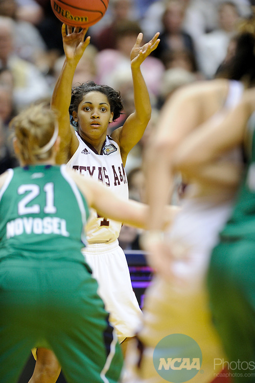 05 APR 2011: Sydney Carter of Texas A&M passes the ball to Danielle Adams (23) during the Division I Women's Basketball Championship held at Conseco Field in Indianapolis, IN. Texas A&M defeated the University of Notre Dame 76-70 to claim the national title. Stephen Nowland/NCAA Photos