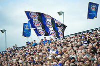 A Bath Rugby fan in the crowd waves a giant flag in support. Aviva Premiership match, between Bath Rugby and Newcastle Falcons on September 10, 2016 at the Recreation Ground in Bath, England. Photo by: Patrick Khachfe / Onside Images