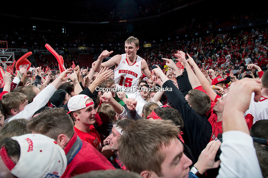 Wisconsin Badgers forward Sam Dekker (15) celebrates with fans after a Big Ten Conference NCAA college basketball game against the Michigan Wolverines Saturday, February 9, 2013, in Madison, Wis. The Badgers won 65-62 (OT). (Photo by David Stluka)