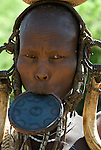 Woman with lip plate wearing head gear, Mursi Tribe, Mago National Park, Lower Omo Valley, Ethiopia, portrait, person, one, tribes, tribal, indigenous, peoples, Southern, ethnic, rural, local, traditional, culture, primitive.Africa....