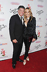 BEVERLY HILLS, CA- SEPTEMBER 13: TV personalities John Bluher (L) and Taylor Armstrong attend the Brent Shapiro Foundation for Alcohol and Drug Awareness' annual 'Summer Spectacular Under The Stars' at a private residence on September 13, 2014 in Beverly Hills, California.