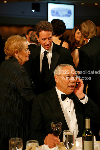 Washington, DC - May 9, 2009 -- Secretary of the Treasury Timothy Geithner chats with former Secretary of State Madeleine Albright as former Secretary of State Colin Powell talks on his cell phone prior to the annual White House Correspondents' Association gala dinner at the Washington Hilton Hotel, Washington, DC, Saturday, May 9, 2009..Credit: Martin H. Simon - Pool via CNP