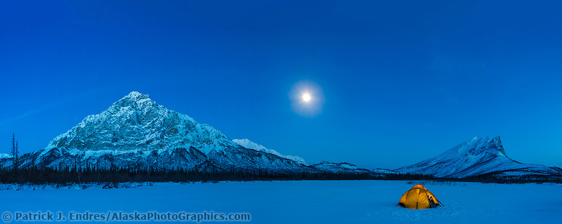 Yellow tent under the moonlight, Brooks Range Mountains, Alaska.