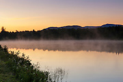 Durand Lake in Randolph, New Hampshire at sunrise during the foggy summer morning.