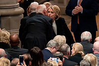 Former Secretary of State Hilary Clinton, right, greets former Vice President Joe Biden, left, before a State Funeral for former President George H.W. Bush at the National Cathedral, Wednesday, Dec. 5, 2018, in Washington. <br /> Credit: Andrew Harnik / Pool via CNP / MediaPunch