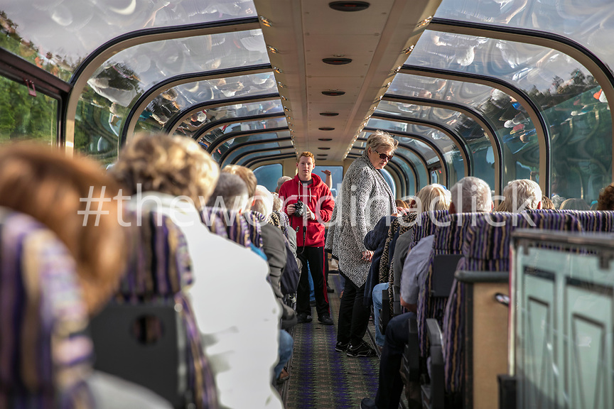 USA, Alaska, Denali National Park, the McKinley Explorer can seat 86 to 88 passengers in the upper level dome which offers a 360 degree view, these passengers are traveling the Alaska Railway from Denali to Anchorage