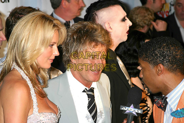 PENNY LANCASTER & ROD STEWART.Conde' Nast Media Group Presents Fashion Rocks 2004   Radio City Music Hall in New York City..September 8, 2004 .headshot, portrait, celebrity couple.www.capitalpictures.com.sales@capitalpictures.com.© Capital Pictures