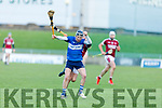Cian Hussey of St Brendans makes a clean catch of the sliotar despite the pressure be applied by Causeway's Keith Carmody in the Division 1 County Hurling League final