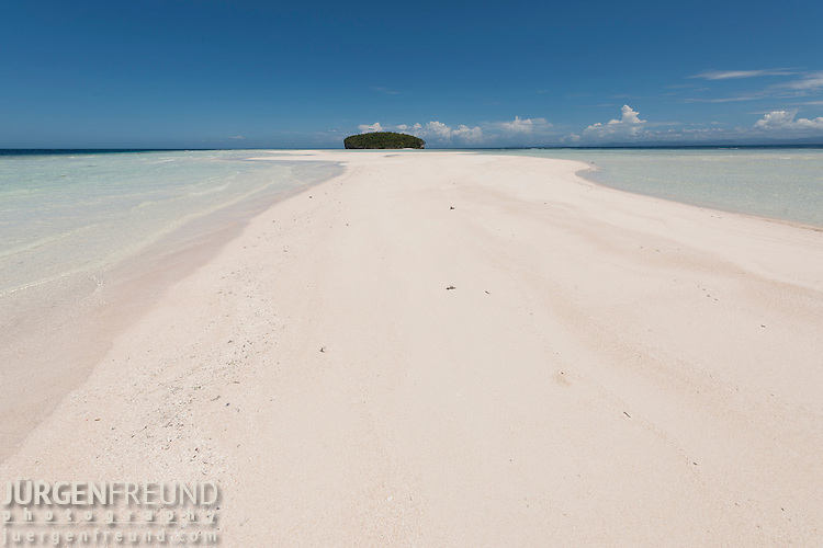 White sandy beach of one of the Raja Ampat islands
