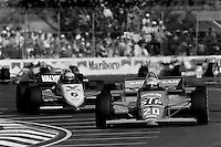 MIAMI, FL - NOVEMBER 9: Bruno Giacomelli drives his March 85C/Cosworth ahead of Roberto Moreno in a March 85C/Cosworth during the Beatrice Indy Challenge CART IndyCar race on the temporary street circuit in Tamiami Park in Miami, Florida, on November 9, 1985.