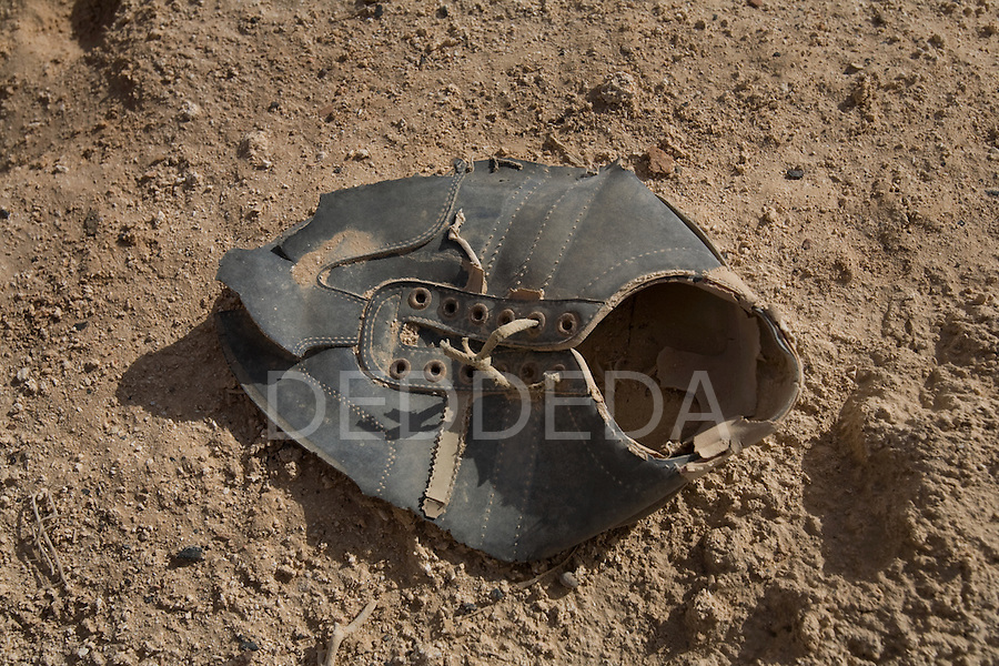 A dusty and discarded shoe found in a cemetery in Siwa Town of the Siwa Oasis, Egypt.