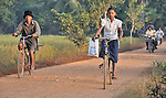 Srey Mao, 14, rides her bike to school in Khnach, a village in the Kampot region of Cambodia.