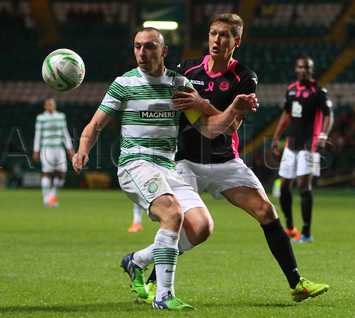 03.12.2014.  Glasgow, Scotland. Scottish Premier League.  Celtic versus Partick Thistle. Scott Brown holds off James Craigen