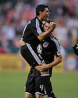 DC United midfielder Chirstian Gomez (10) celebrates with teammate Marc Burch (4) his goal in the 41th minute of the game .  DC United defeated the Chicago Fire 2-1 at  RFK Stadium, Saturday June 13, 2009.