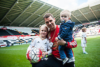 on the pitch with team players and staff during a lap of honour after the Barclays Premier League match between Swansea City and Manchester City played at the Liberty Stadium, Swansea on the 15th of May  2016