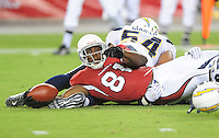 Aug. 22, 2009; Glendale, AZ, USA; Arizona Cardinals wide receiver (81) Anquan Boldin stretches for yardage against the San Diego Chargers during a preseason game at University of Phoenix Stadium. Mandatory Credit: Mark J. Rebilas-