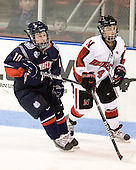 Stephanie Raithby (UConn - 10), Maggie DiMasi (NU - 4) - The visiting University of Connecticut Huskies defeated the Northeastern University Huskies 4-2 (EN) in NU's senior game on Saturday, February 19, 2011, at Matthews Arena in Boston, Massachusetts.