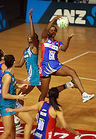 20.03.2010 Mystics Althea Byfield and Thunderbirds Carla Borrego in action during the ANZ Champs Netball match between the Mystics and Thunderbirds at Trusts Stadium in Auckland. Mandatory Photo Credit ©Michael Bradley.