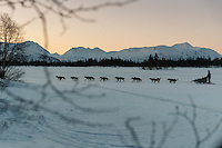 A dog team departs Finger Lake checkpoint on Monday, March 3, during the Iditarod Sled Dog Race 2014.<br /> <br /> PHOTO (c) BY JEFF SCHULTZ/IditarodPhotos.com -- REPRODUCTION PROHIBITED WITHOUT PERMISSION