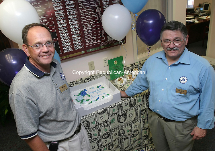WATERTOWN,  CT 04 August 2005 -080405BZ09- Tom Lawton, chair of the Board of Directors, and Ray Alexander, President and C.E.O.,  pose with cake put out for customers during a carnival/fair at the Technology Groups Federal Credit Union.  The credit union is celebrating its 70th anniversary this month.<br /> Jamison C. Bazinet Photo