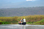 Parque Nacional de Chapada Diamantina, Lencois, Bahia, Brazil: Tourists with their local travel guides on a boat trip through the marshy landscape of the Mini-Pantanal do Marimbus. --- Info: In response to the growing ecotourism in 1985 the Chapada Diamantina National Park (Parque Nacional da Chapada Diamantina) was established as a 1520 sqkm national park approximately 400 kilometres inland from Salvador de Bahia. Today the Chapada Diamantina is recognized as one of Brazil top hiking and outdoor activities destinations. The National Park is a beautiful region comprising of table top mountains, gorges, waterfalls, huge caves and crystalline lakes and bathing pools. Lencois is the main access point to the Chapada Diamantina. --- No signed releases available.