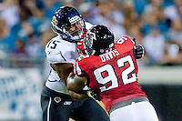 August 19, 2011:   Jacksonville Jaguars offensive tackle Eugene Monroe (75) blocks Atlanta Falcons defensive end Chauncey Davis (92) during pre season action between the Jacksonville Jaguars and the Atlanta Falcons at EverBank Field in Jacksonville, Florida.   Jacksonville defeated the Falcons 15-13.........