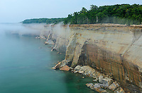 Lake Superior fog climbing the towering 200 ft. cliffs of Pictured Rocks National Lakeshore. Munising, MI