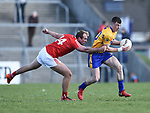 Kieran Malone of Clare in action against Conor Grimes of Louth during their national League game in Cusack Park. Photograph by John Kelly.