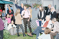 A doctor asks about the opioid epidemic as Democratic presidential candidate and spiritual guru Marianne Williamson speaks to a small crowd in the back yard of Kathleen O'Donnell at a campaign house party event in Keene, New Hampshire, on Wed., May 22, 2019.