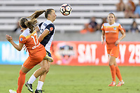 Houston, TX - Saturday July 15, 2017: Havana Solaun heads the ball away from Andressa Cavalari Machry during a regular season National Women's Soccer League (NWSL) match between the Houston Dash and the Washington Spirit at BBVA Compass Stadium.