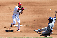Luis Mateo #26 of the Springfield Cardinals turns a double play during a game against the Tulsa Drillers at Hammons Field on May 7, 2013 in Springfield, Missouri. (David Welker/Four Seam Images)