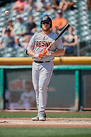 A.J. Reed (18) of the Fresno Grizzlies bats against the Salt Lake Bees at Smith's Ballpark on September 4, 2017 in Salt Lake City, Utah. Fresno defeated Salt Lake 9-7. (Stephen Smith/Four Seam Images)
