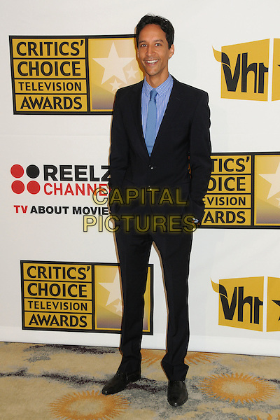 Danny Pudi.1st Annual Critics' Choice Television Awards held at The Beverly Hills Hotel, Beverly Hills, California, USA, .20th June 2011..full length navy blue suit tie hands in pockets .CAP/ADM/BP.©Byron Purvis/AdMedia/Capital Pictures.