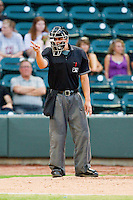Home plate umpire Doug Del Bello makes a strike call during the Carolina League game between the Potomac Nationals and the Winston-Salem Dash at BB&T Ballpark on July 8, 2013 in Winston-Salem, North Carolina.  The Dash defeated the Nationals 12-9.  (Brian Westerholt/Four Seam Images)