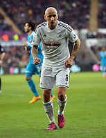 SWANSEA, WALES - FEBRUARY 07: Jonjo Shelvey of Swansea during the Premier League match between Swansea City and Sunderland AFC at Liberty Stadium on February 7, 2015 in Swansea, Wales.