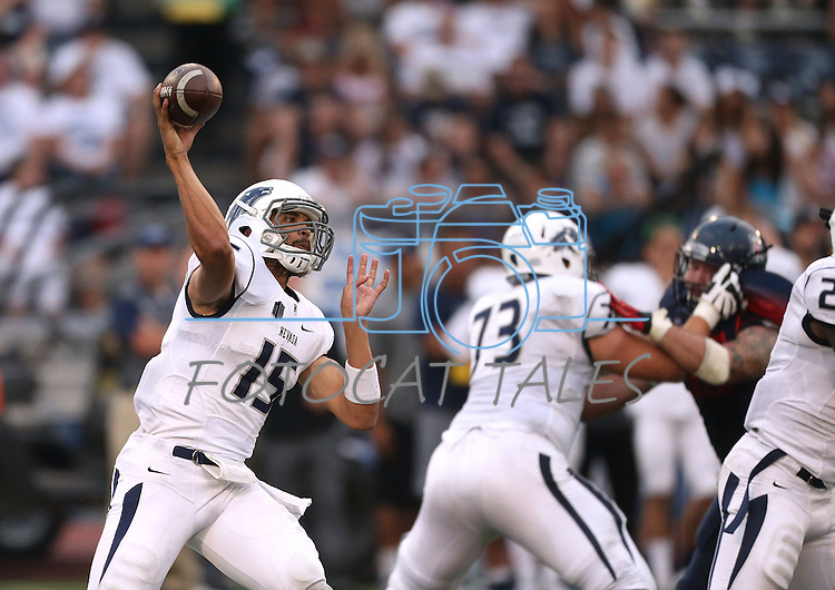 Nevada quarterback Tyler Stewart throws against Arizona in an NCAA college football game in Reno, Nev., on Saturday, Sept. 12, 2015.(AP Photo/Cathleen Allison)