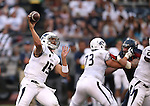Nevada quarterback Tyler Stewart throws against Arizona in an NCAA college football game in Reno, Nev., on Saturday, Sept. 12, 2015.(AP Photo/Cathleen Allison)