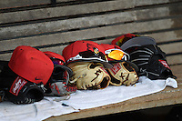 Illinois State Redbirds hats, gloves and sunglasses on the team bench after game against the Bowling Green Falcons on March 11, 2015 at Chain of Lakes Stadium in Winter Haven, Florida.  Illinois State defeated Bowling Green 8-7.  (Mike Janes/Four Seam Images)