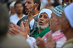 Members of Egyptian sufi muslim group perform as they parade the street during a ritual to commemorate the Hijri New Year, also known as Islamic New Year, in Cairo on October 26, 2014. The Islamic year lasts for about 354 days and consists of 12 months. Muharram is the first month and some Muslims mark the start of the Islamic year on the first day of Muharram. Photo by Amr Sayed