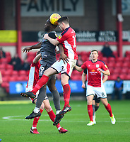 Lincoln City's John Akinde battles with Crewe Alexandra's Eddie Nolan<br />  <br /> Photographer Andrew Vaughan/CameraSport<br /> <br /> The EFL Sky Bet League Two - Crewe Alexandra v Lincoln City - Wednesday 26th December 2018 - Alexandra Stadium - Crewe<br /> <br /> World Copyright &copy; 2018 CameraSport. All rights reserved. 43 Linden Ave. Countesthorpe. Leicester. England. LE8 5PG - Tel: +44 (0) 116 277 4147 - admin@camerasport.com - www.camerasport.com